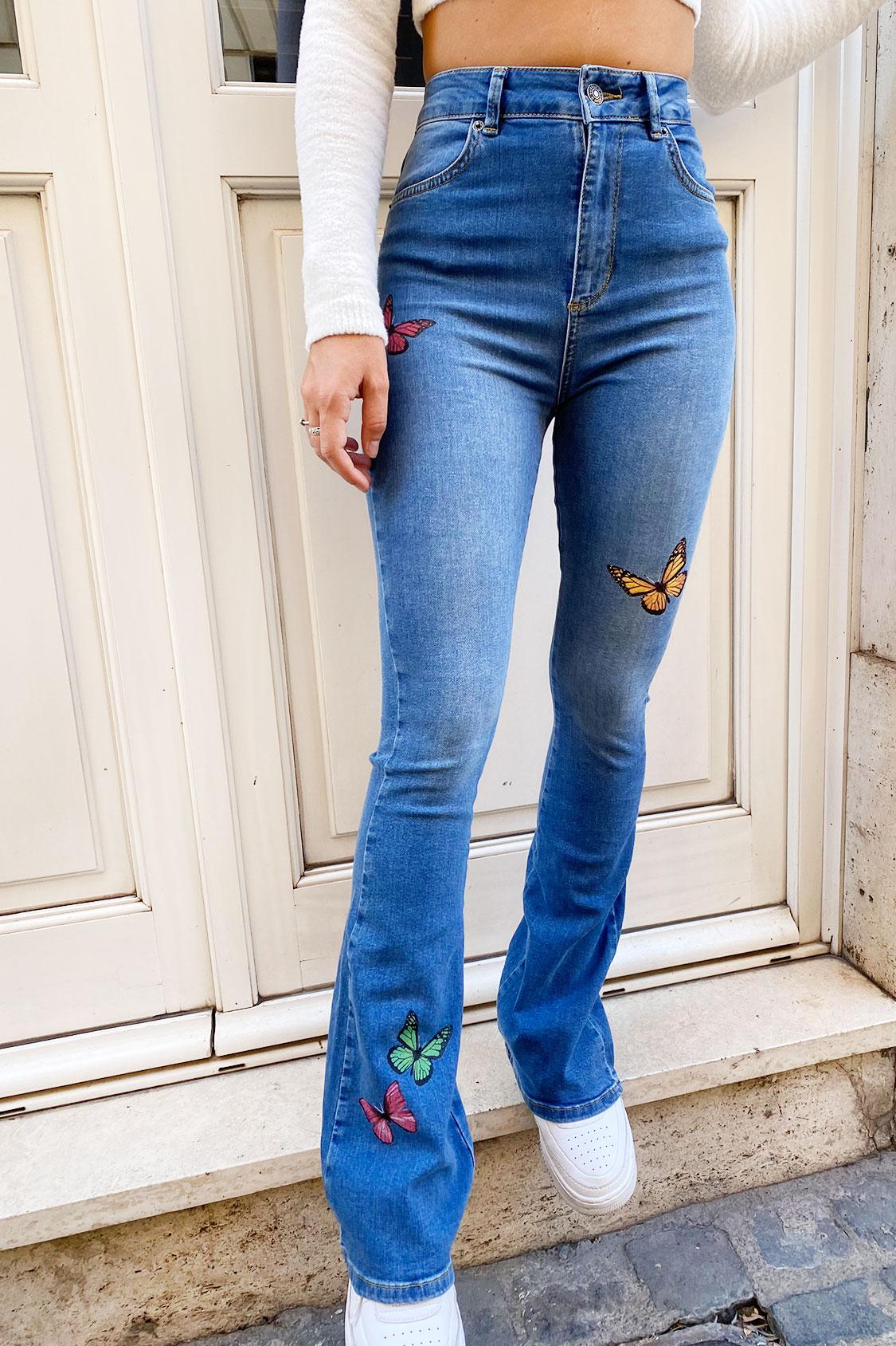 Jeans a zampa farfalle