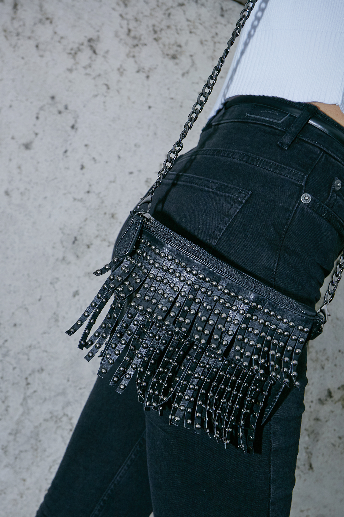 Faux leather fringed bag