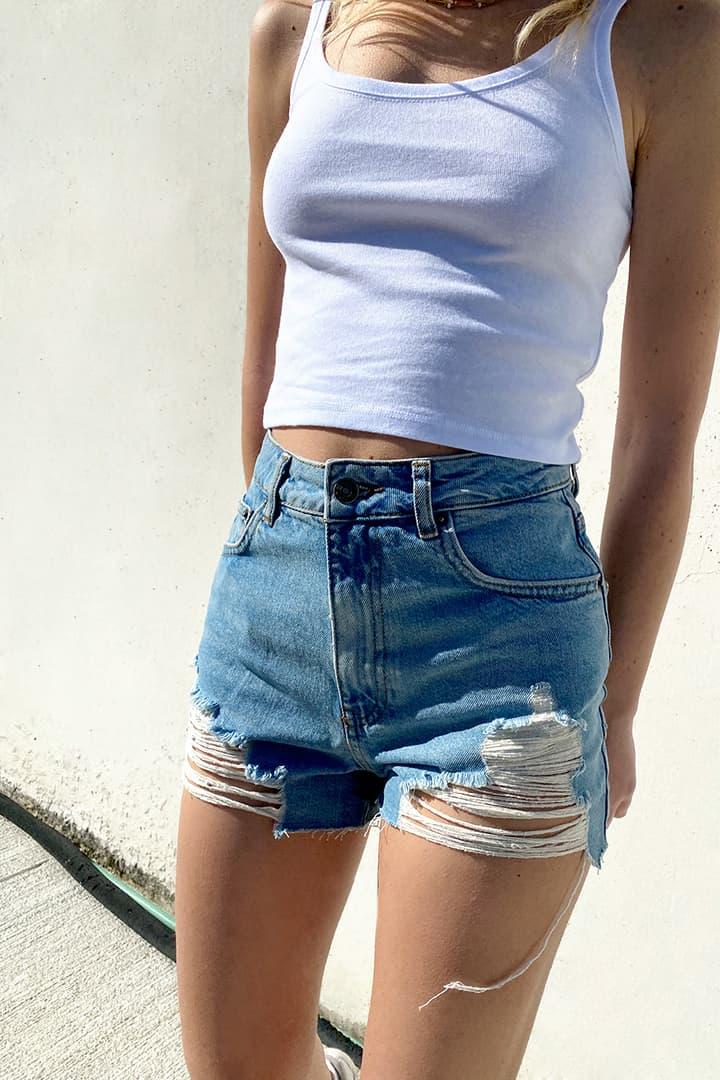 Raw hem distressed denim shorts